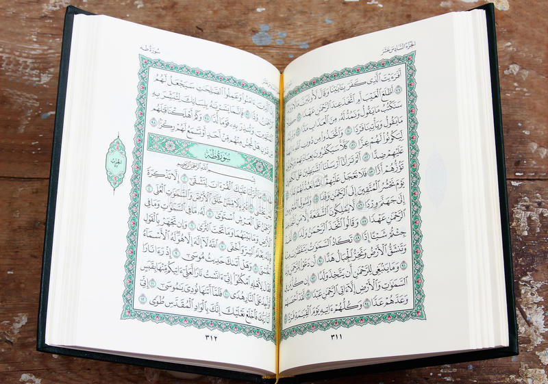 Koran holy book with rosary. Koran or quran, holy book on Islam religion royalty free stock photo