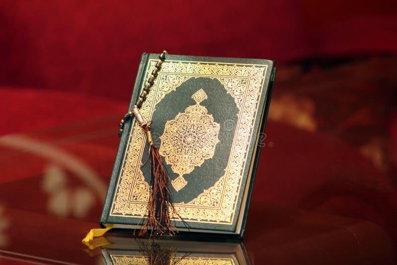 Koran holy book with rosary. Koran or quran, holy book of Islam religion royalty free stock photo