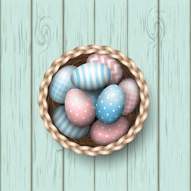 Korb mit gemalten Ostereiern auf blauem hölzernem Hintergrund, Illustration lizenzfreie abbildung