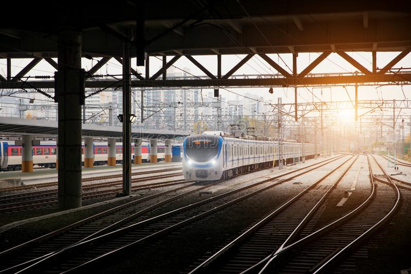 Korea train on railway with skyline at Seoul, South Korea for tr stock images