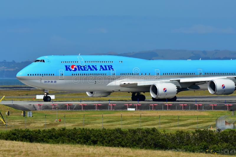 Korean Air Boeing 747-8i super jumbo taxiing at Auckland International Airport. AUCKLAND, NEW ZEALAND - DECEMBER 17: Korean Air Boeing 747-8i super jumbo taxiing royalty free stock photography