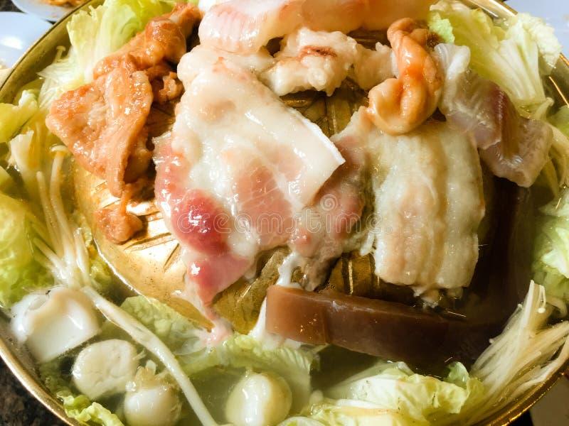 Korean Barbecue in Thai Style.Thai Barbecue Buffet.Moo Kratha stock photos