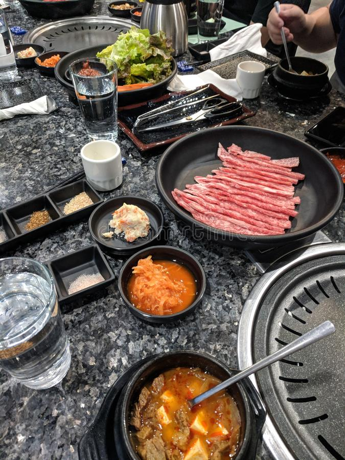 Korean bbq table spread royalty free stock photo