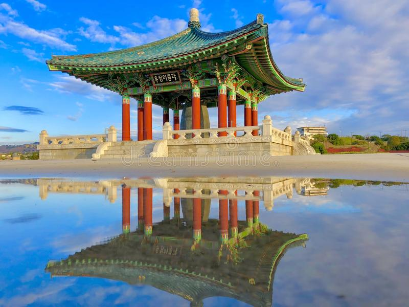 The Korean Bell of Friendship reflected stock photo
