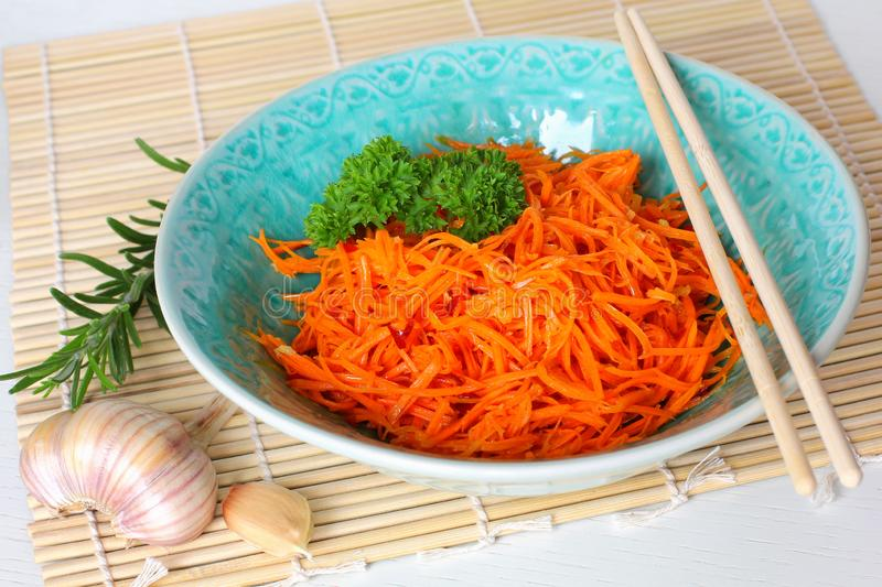 Korean carrot salad. Korean Style Spicy Carrot Salad with Chopsticks in Bowl stock photos