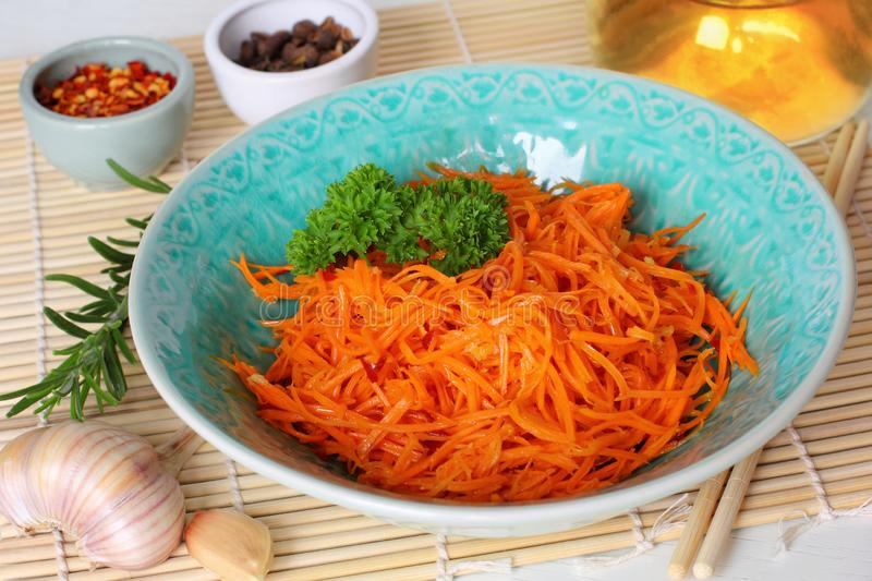 Korean carrot salad. Korean Style Spicy Carrot Salad with Chopsticks in Bowl stock images