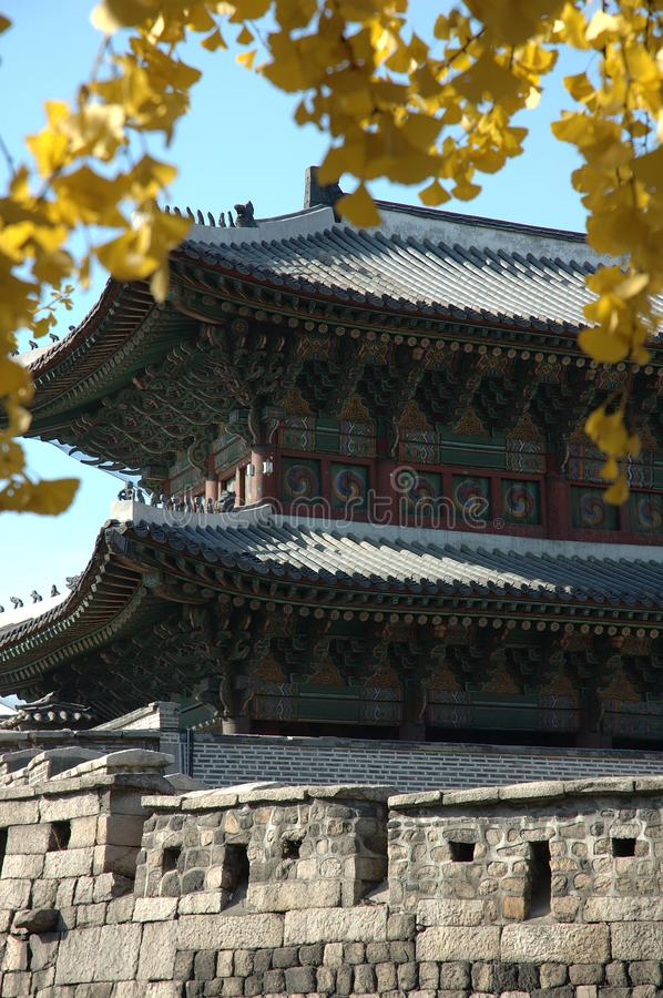 Korean city gate corner with autumn leaves in Seoul royalty free stock photos
