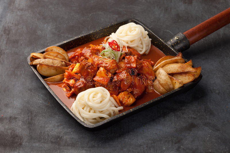 Korean crazy chicken of Gounod gun carriage with rice vermicelli stock images