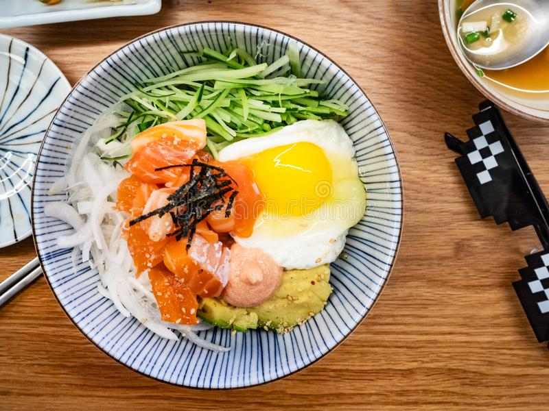 Served bowl with bibimbap with salmon sashimi stock photos