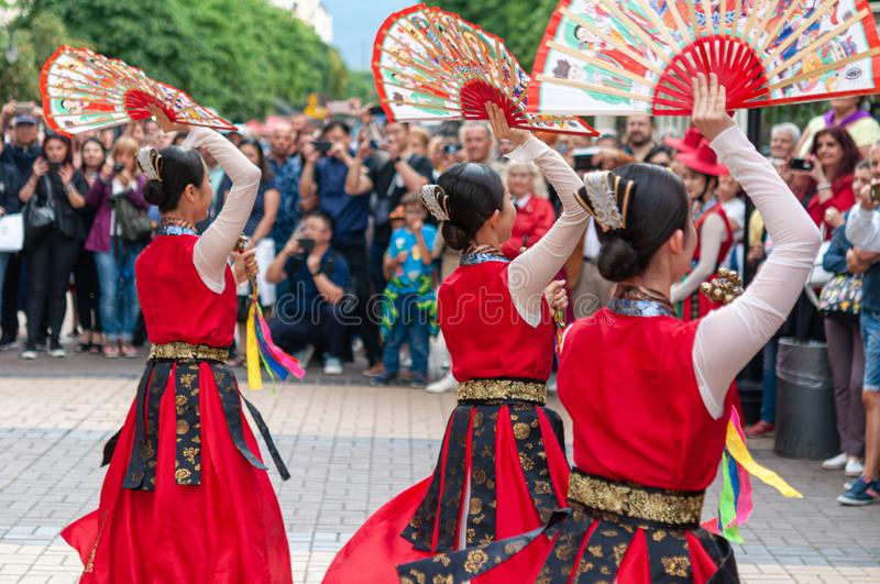 Korean ethnic dancers perform fan. Korean ethnic dancers perform, Buchaechum, fan dance, in the Korean stock photo