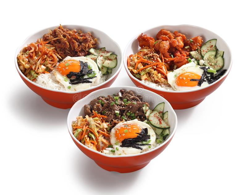 Korean food bowls. Korean rice toppings in bowls on white background royalty free stock image