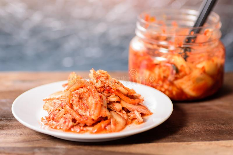 Korean food, kimchi cabbage on white dish. And a jar with chopsticks for eating.Healthy food royalty free stock photography