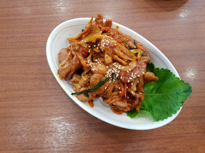 Korean food style, Top view of spicy stir fried pork on white plate. stock images