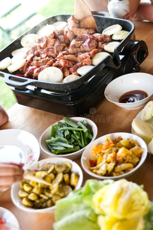 Korean food table. With portable cooker royalty free stock photo
