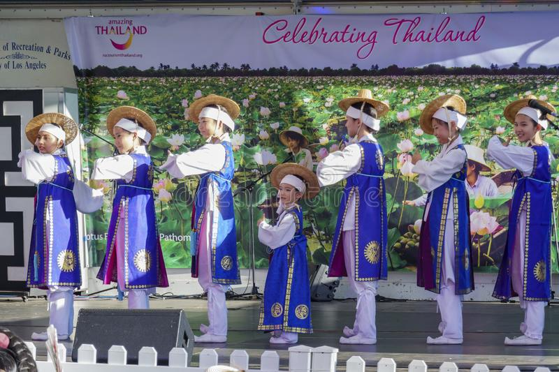 Korean girls dancing on the stage for Lotus Festival Echo Park royalty free stock images