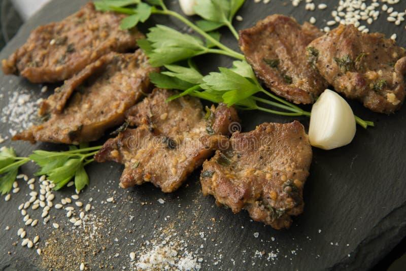 Korean grilled meat, bulgogi, barbecue meat closeup stock images