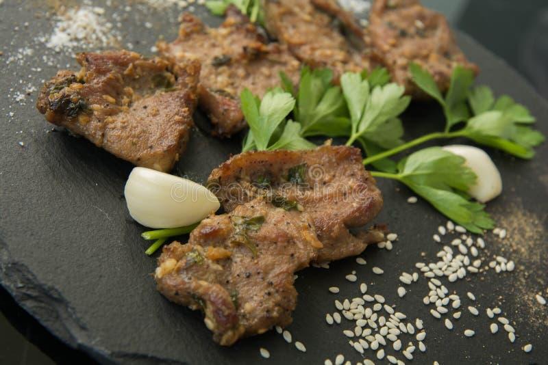 Korean grilled meat, bulgogi, barbecue meat closeup stock photos