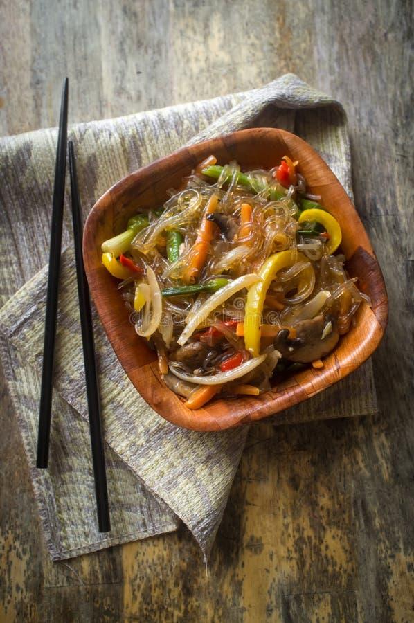 Korean Japchae Stir Fried Noodles. Korean Japchae vegetarian stir fried cellophane noodles with vegetables royalty free stock images