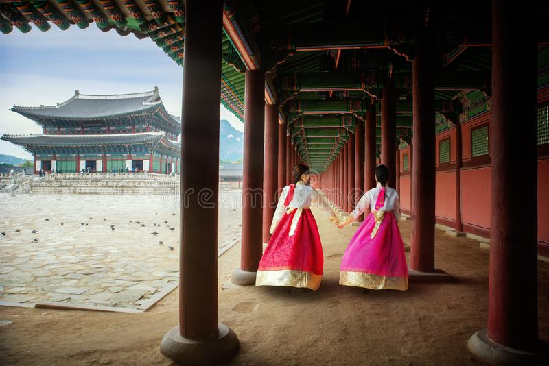 Korean lady in Hanbok or Korea gress and walk in an ancient palace stock image
