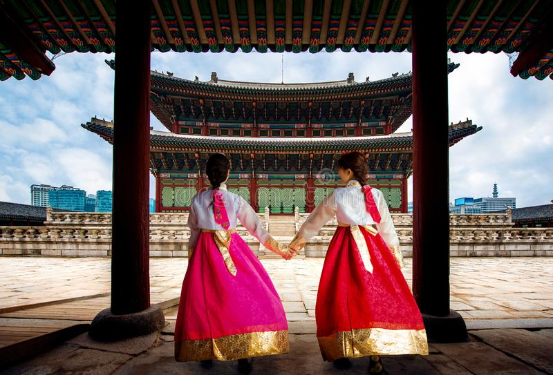 Korean lady in Hanbok or Korea gress and walk in an ancient town. And Gyeongbokgung Palace in seoul, Seoul city, South Korea royalty free stock photo