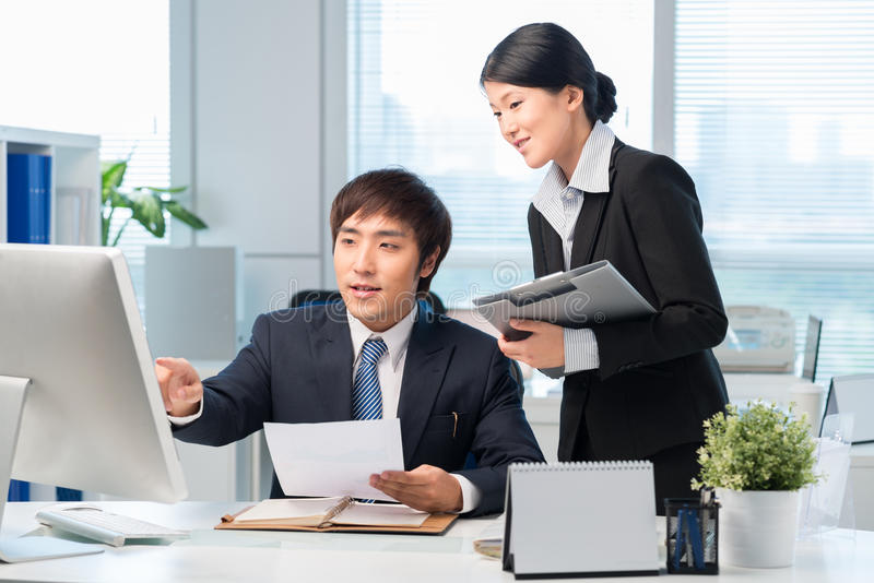 Korean manager and his assistant royalty free stock images
