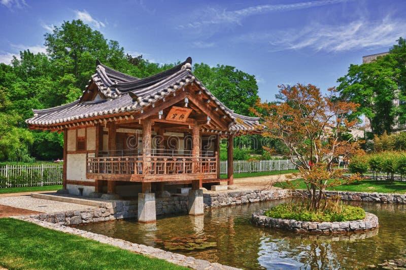 Korean Pagoda with small lake in the Park.  royalty free stock photos