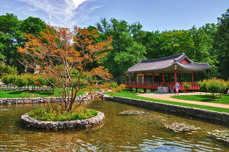 Korean Pagoda with small lake in the Park.  stock images