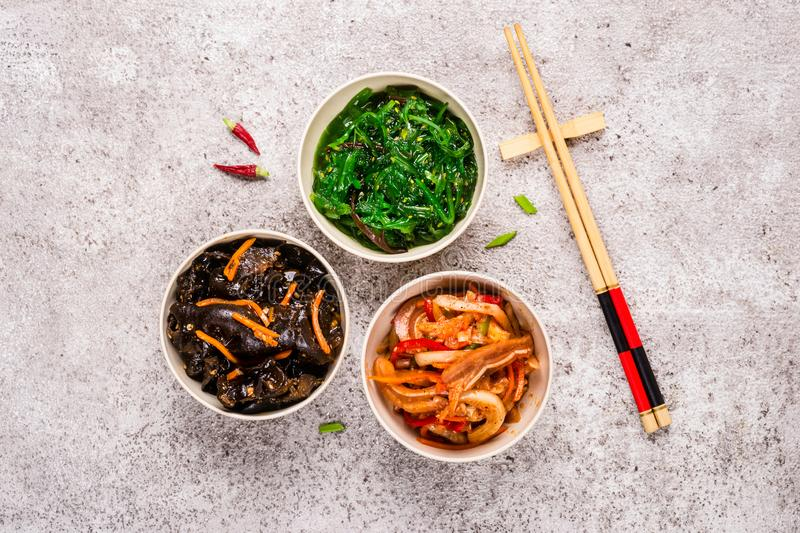 Korean pickled food set and chopsticks on gray background stock photo