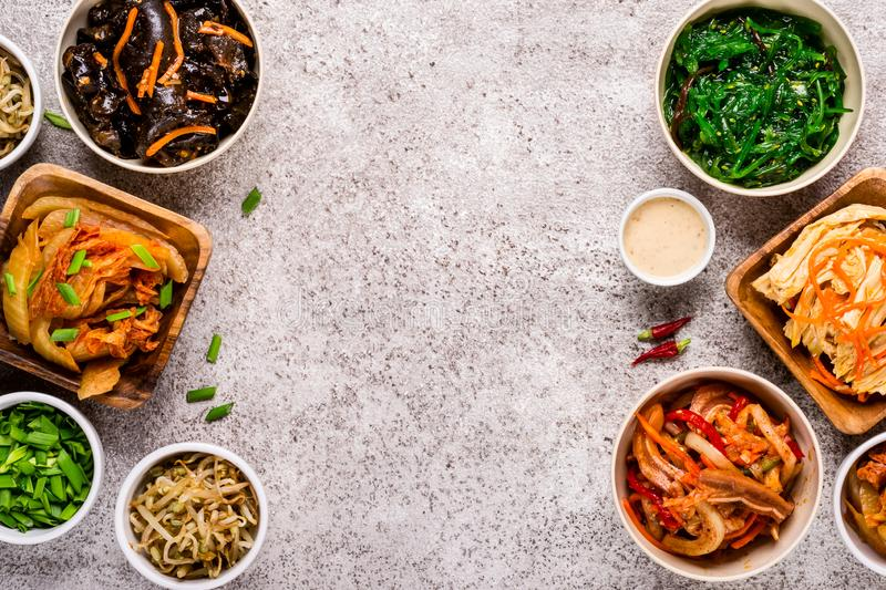 Korean spicy and vegetable pickled salads. Asian food background.  royalty free stock photos
