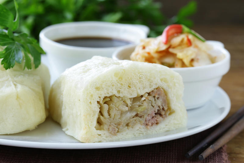 Korean steam meat pies (pigodi) served with soy sauce royalty free stock photos