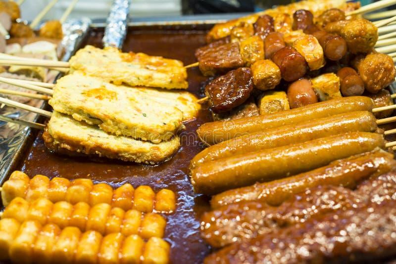 Korean Street Food. Variety of Korean street food on skewers and hot spicy sauce royalty free stock images