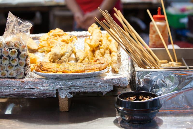 Korean street food, Seoul, South Korea. Korean street food: gimbap rolls and fritters at the night street stall, Seoul, South Korea stock photography