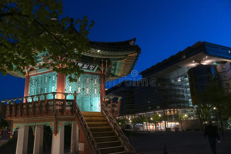 Korean Tongiljeong Pavilion in Berlin, Germany. Berlin, Germany - April 20, 2019: Tongiljeong Pavilion, traditional Korean stone and wood gazebo, set up in 2015 stock image