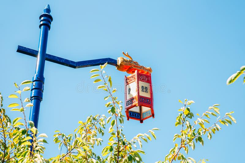 Korean traditional street lamp under blue sky royalty free stock photography