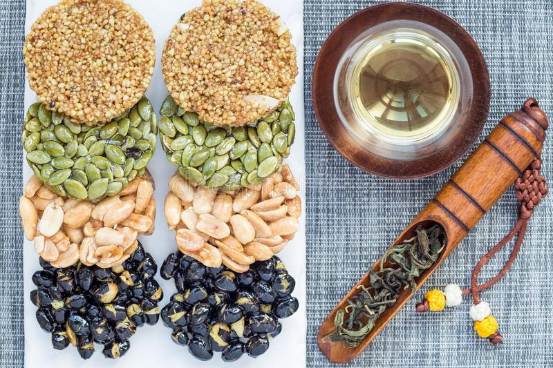 Korean traditional sweet snacks with peanuts, pumpkin seeds, black soybeans and chinese buckwheat. Healthy energy snacks. Top view royalty free stock images