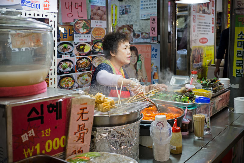 Korean Vendor at Her Stall royalty free stock image