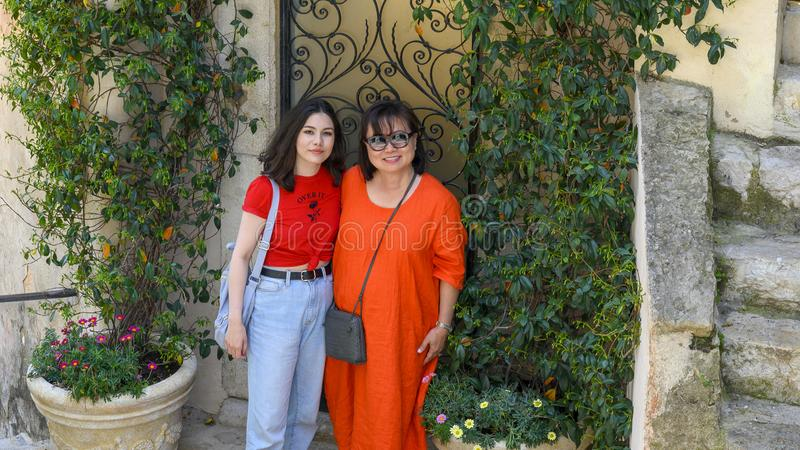 Korean woman and Amerasian daughter on vacation in Eze, France stock photography