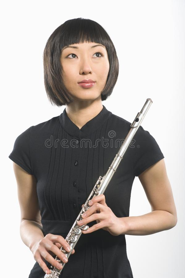 Korean Woman Holding Flute. Beautiful Korean woman holding flute isolated over white background stock photos