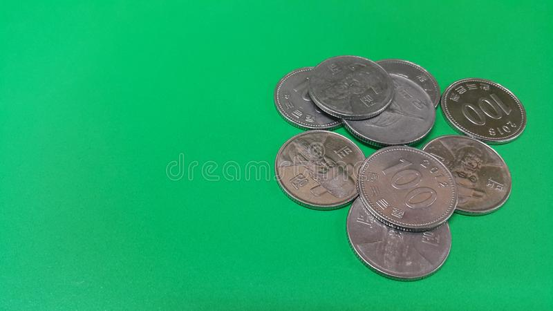 Korean won coin scattered over a green floor. Silver shining Korean won coin scattered over a green floor money cash finance currency metal economy investment stock photo