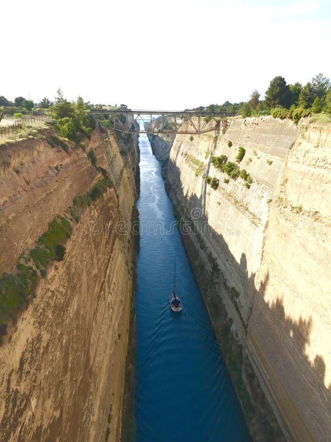 Korinth Canal, Greece. The thin, long, deep Korinth Canal, dug by man, a channel of water royalty free stock photo