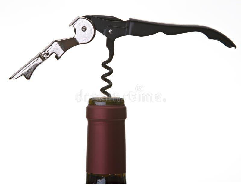 Korken-Schraube in der Flasche lizenzfreie stockfotografie