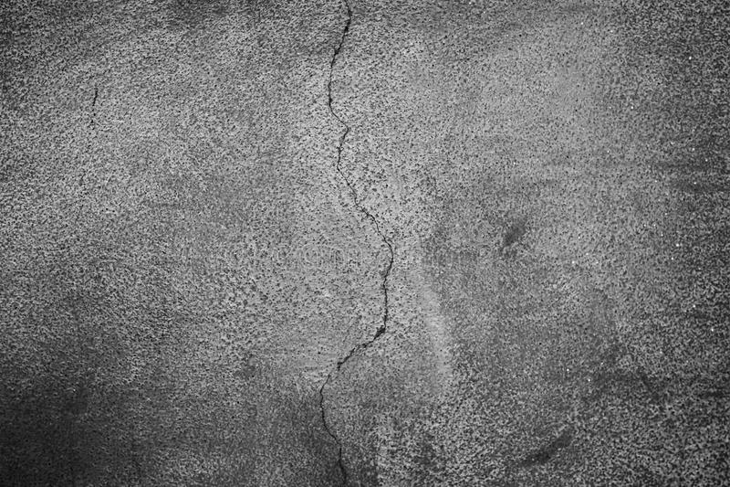 Kornig mörk grungy väggtextur royaltyfria foton
