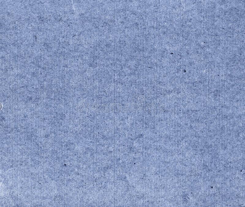 Kornigt blått papper royaltyfria bilder