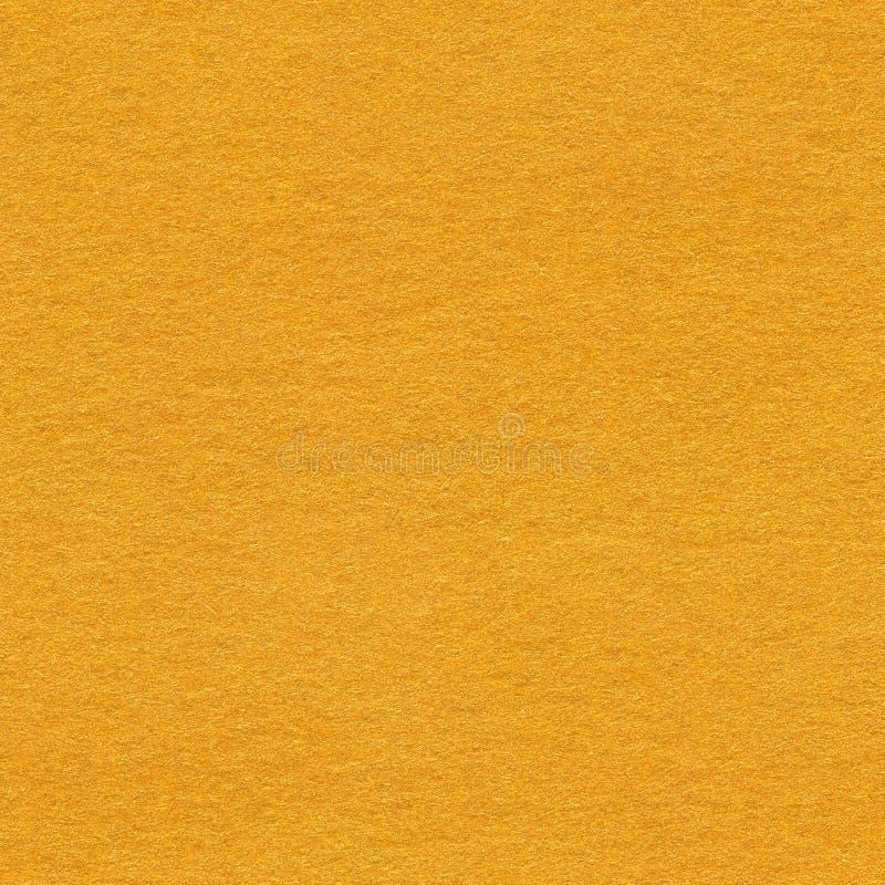 Kornigt pappers- ljus - orange bakgrund Sömlös fyrkantig textur, t royaltyfri fotografi