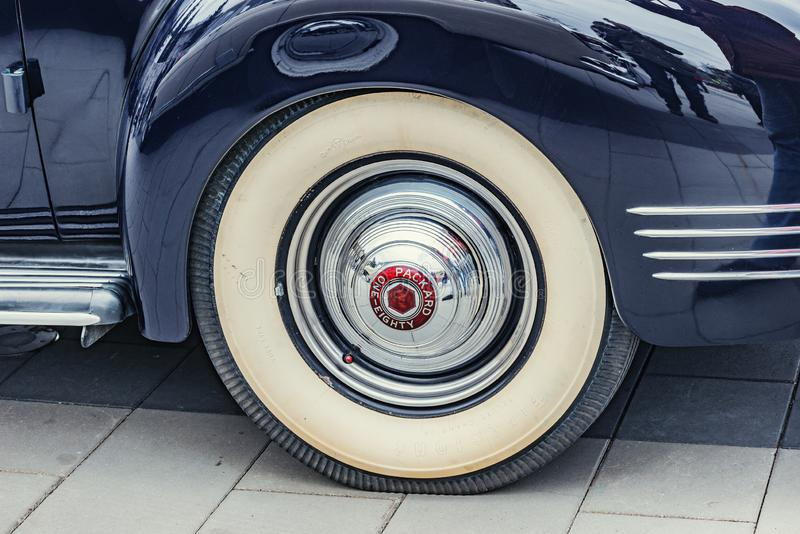 Black Packard car wheel on the city square at retro car parade time royalty free stock image