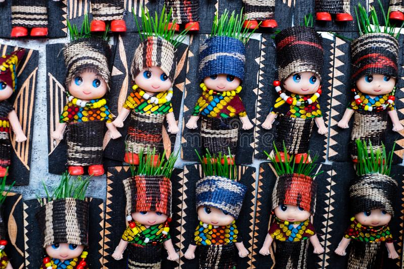 Koronadal, PH - July 18, 2019: Cute dolls dressed in T`nalak clothes displayed during the T`nalak Festival 2019. T`nalak cloth is handwoven and made from stock photography
