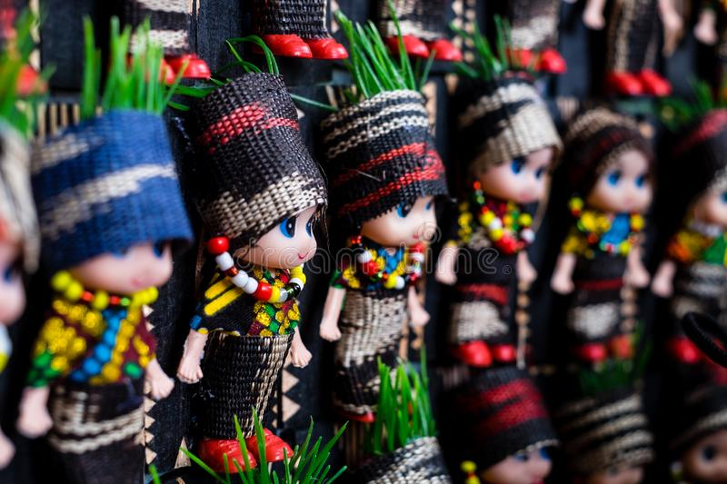 Koronadal, PH - July 18, 2019: Cute dolls dressed in T`nalak clothes displayed during the T`nalak Festival 2019. T`nalak cloth is handwoven and made from royalty free stock image