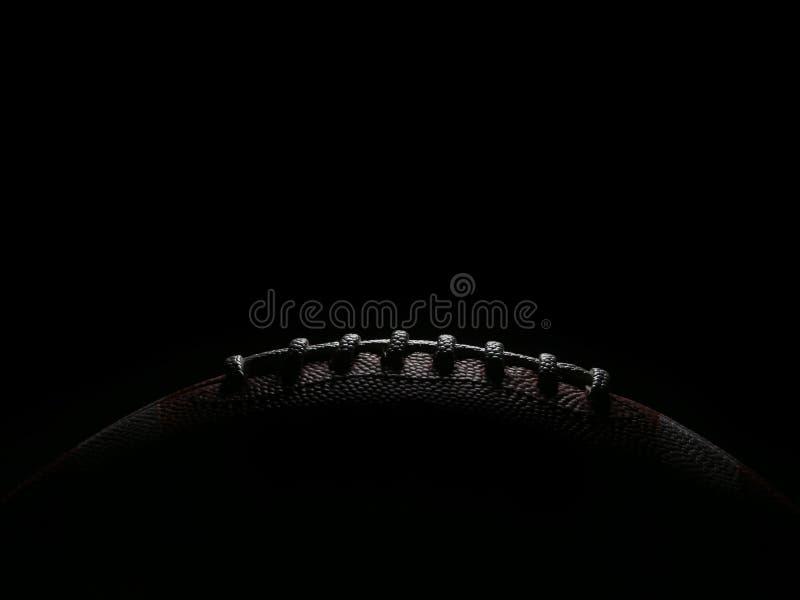Koronki futbol amerykański Gemowa piłka Zaświecająca od koszt stały fotografia stock