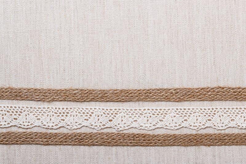 Koronkowa rama na bieliźnianego płótna tle zdjęcie stock