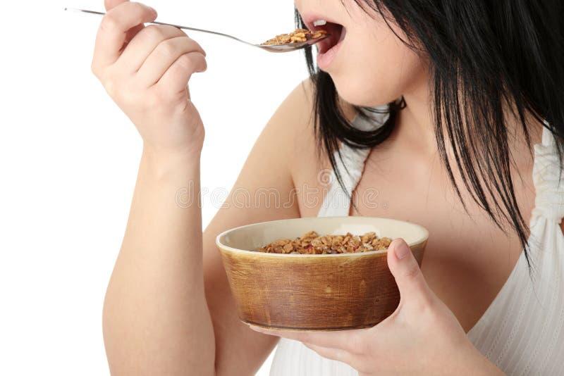 korpulent barn för ätamuslinkvinna royaltyfri foto